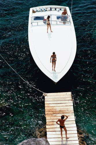 Speedboat Landing by Slim Aarons at FEUTEU