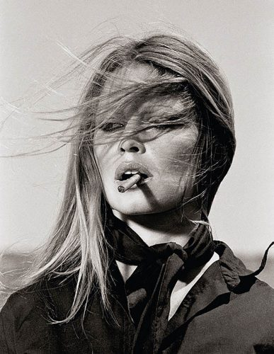 Brigitte Bardot with cigar on the set Les Petroleuses by Terry O'Neill at Terry O'Neill