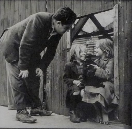 Brendan Behan looking at two children by Daniel Farson at