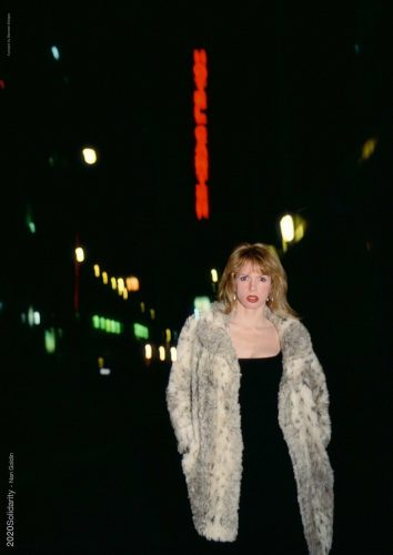 Joey in front of the Ambassador Theater, Times Square, NYC (1997) by Nan Goldin at