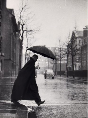 The Rev. Rhinedorp, Vicar of Pimlico, steps out by Thurston Hopkins at