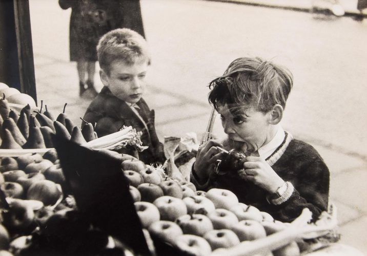 Untitled (Child with Toffee Apple and Gun) by Bert Hardy at