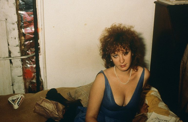 Self-portrait in blue dress, New York City, 1985 by Nan Goldin at Rhodes Contemporary Art